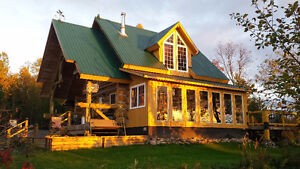 Beautiful log house with amazing lake views.9 plus acres.