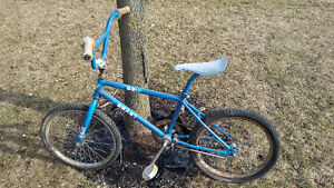 3 vintage BMX bikes and 6 plastic mag wheels for sale