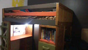 Solid oak loft bed with desk and storage