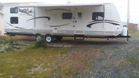 2011 Jasper Trail by Heartland, large slide with quad bunk room