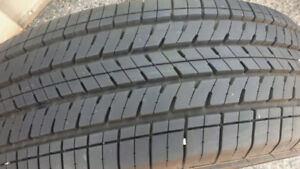 As new 4 x 225/65R17 Bridgestone all season tires, 95%+ tread