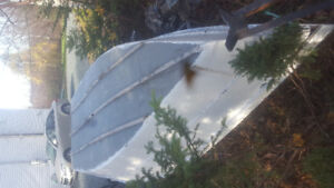 12 ft fibreglass over plywood boat and motor and trailer