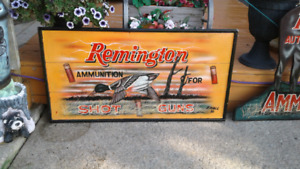 E. HALL ORIGINAL SIGNS ADVERTISEING REMINTON GUNS AND AMMO.