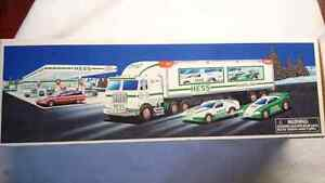 HESS TOY TRUCK AND RACERS INCLUDE TOY TRUCK AND 2 RACE CARS MINT