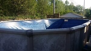 Complete 12' x 24' oval above ground pool
