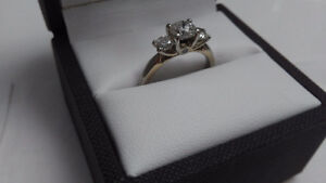 Gorgeous 18 karat platinum tiered3 stone diamond engagement ring