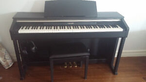 Casio piano with stool