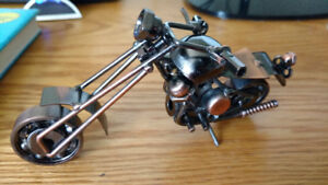 Motorcycle figure made of salvaged metal