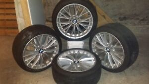 """Set of Four BMW 15"""" rims for sale Drive guard tires, like new."""