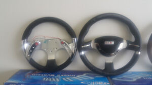 Steering wheels show cars and off road