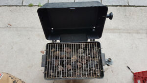 Small picnic table barbecue with 2 propane tanks