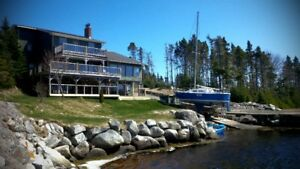 Rare 1 Acre+ Waterfront Home with Private Sandy Beach!