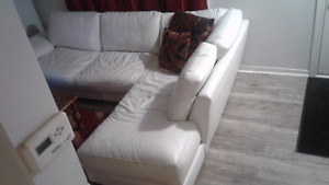 L shaped white leather couch
