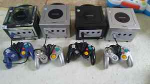 4 gamecube consoles, games and controllers for sale