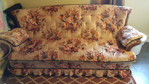10/10 floral couch with pull out bed