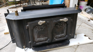 Wood  burning stove insert with fan.