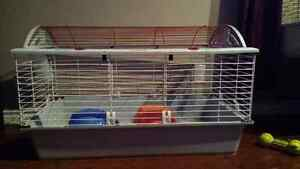 Large rabbit or guinea pig cage 2 houses & water bottle $ 60.00