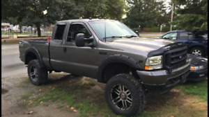 "2002 f250 v10 6"" loft 36"" tires 20"" rims headers full 3"" exhaust"