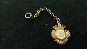 Juicy Couture Emblem with crystals, white enamel & goldtone