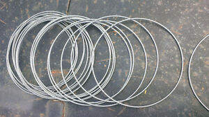 Steel rings, hammered silver painted wire hoops, dreamcatchers?
