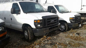 2009 Ford Cargo Van with shelving and roof rack