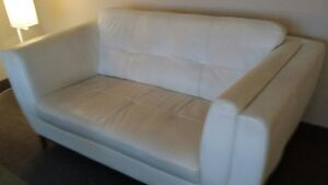 Small white leather sofa (loveseat)