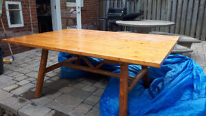 Solid wood dining table, perfect for indoor cottage or rec room.