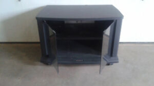 TV   stand  - with glass doors and wheels