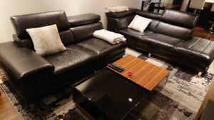 Natuzzi black leather 2 sectional couch