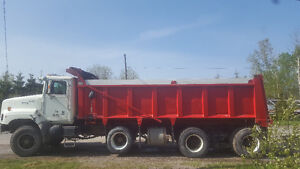 Tri axle dump truck and pup