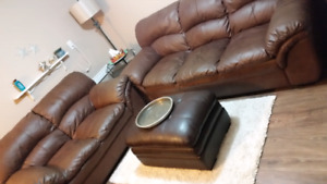 Brown faux leather couch and love seat