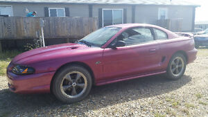 5.0l high output gt with low kms, will consider trade