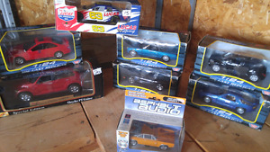 Diecast cars in boxes