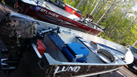 14 foot Lund aluminum boat with a 15 hp suzuki 4 stroke