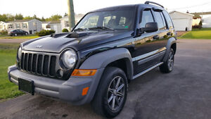 2005 Jeep Liberty and 2006 Acura MDX