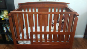 Crib and mattress with toddler conversion and built in drawers!