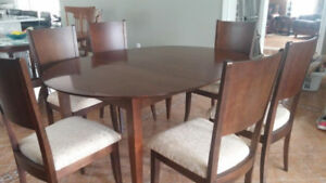 Solid wood table, two leaves and 6 chairs.