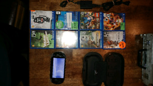 Ps vita in good condition with 8 games