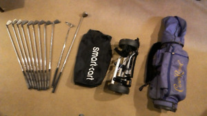 Complete set of golf clubs, cart and bag