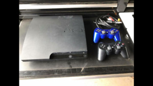 PS3 with Games & two controllers