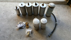 3 volvo oil & 1 fuel filter and 1 air dog or fass fuel filter