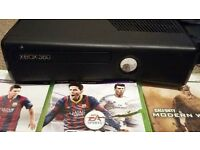 xbox 360 with three games