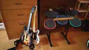 Wii guitar hero game with 2 guitars & drums for sale St. John's Newfoundland image 1