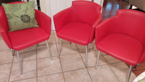 Red swivel accent chairs