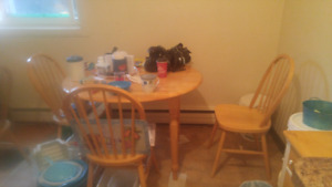 Kitchen table with 4 chairs in excellent condition. Call 204-952