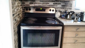 """Stainless Steel GE 30"""" 5.3 cu. ft. Capacity.  electric stove"""