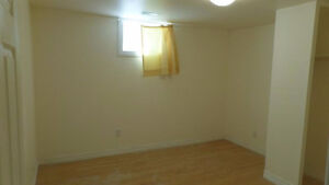 Three bedroom and large living room basement apartment