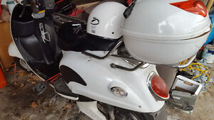 Lightly used e-bike scooter and helmet