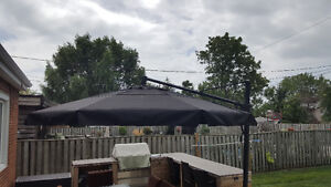 Oversized quality 3 year old patio umbrella with stand.