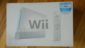 Wii console, controllers, nunchucks and games